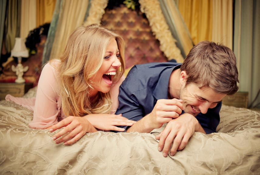 couple-laughing-bed