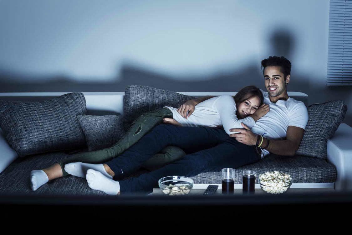 couple-watching-tv-on-couch